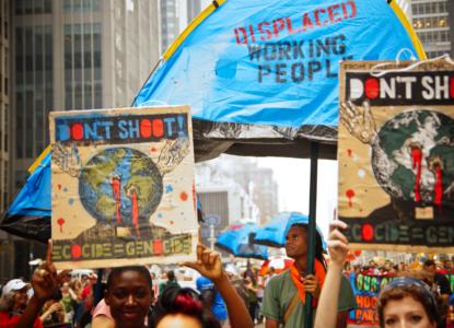 Ecocide genocide c Joe Brusky via Flickr aangepast